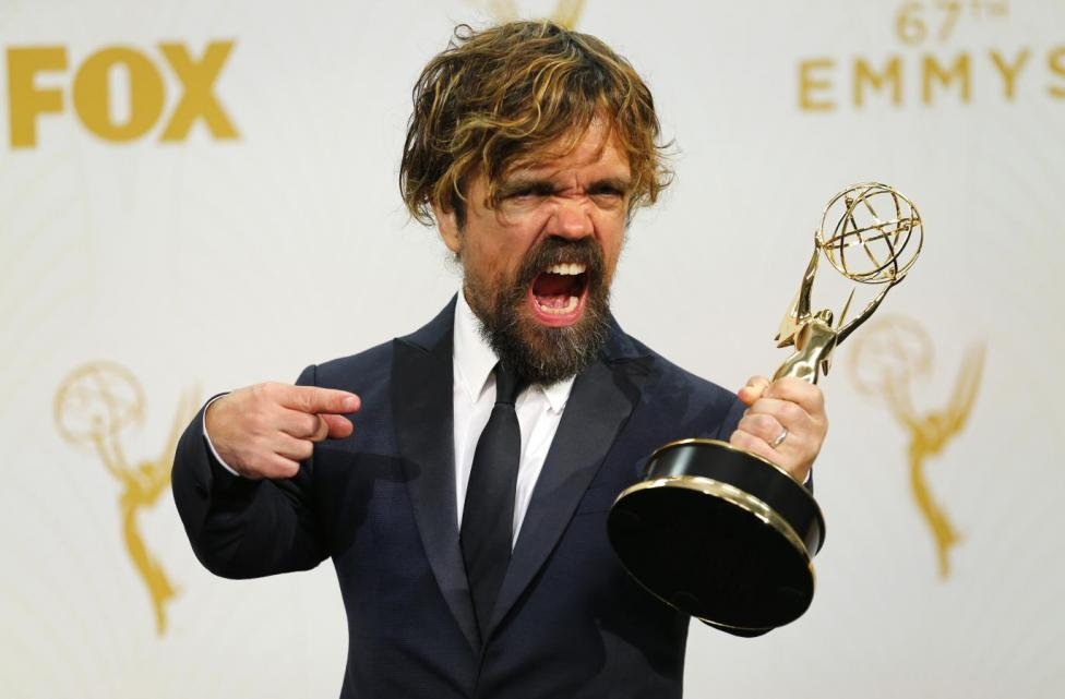 "Actor Peter Dinklage poses backstage with his award for Outstanding Supporting Actor in a Drama Series for his role in HBO's ""Game of Thrones"". REUTERS/Mike Blake"